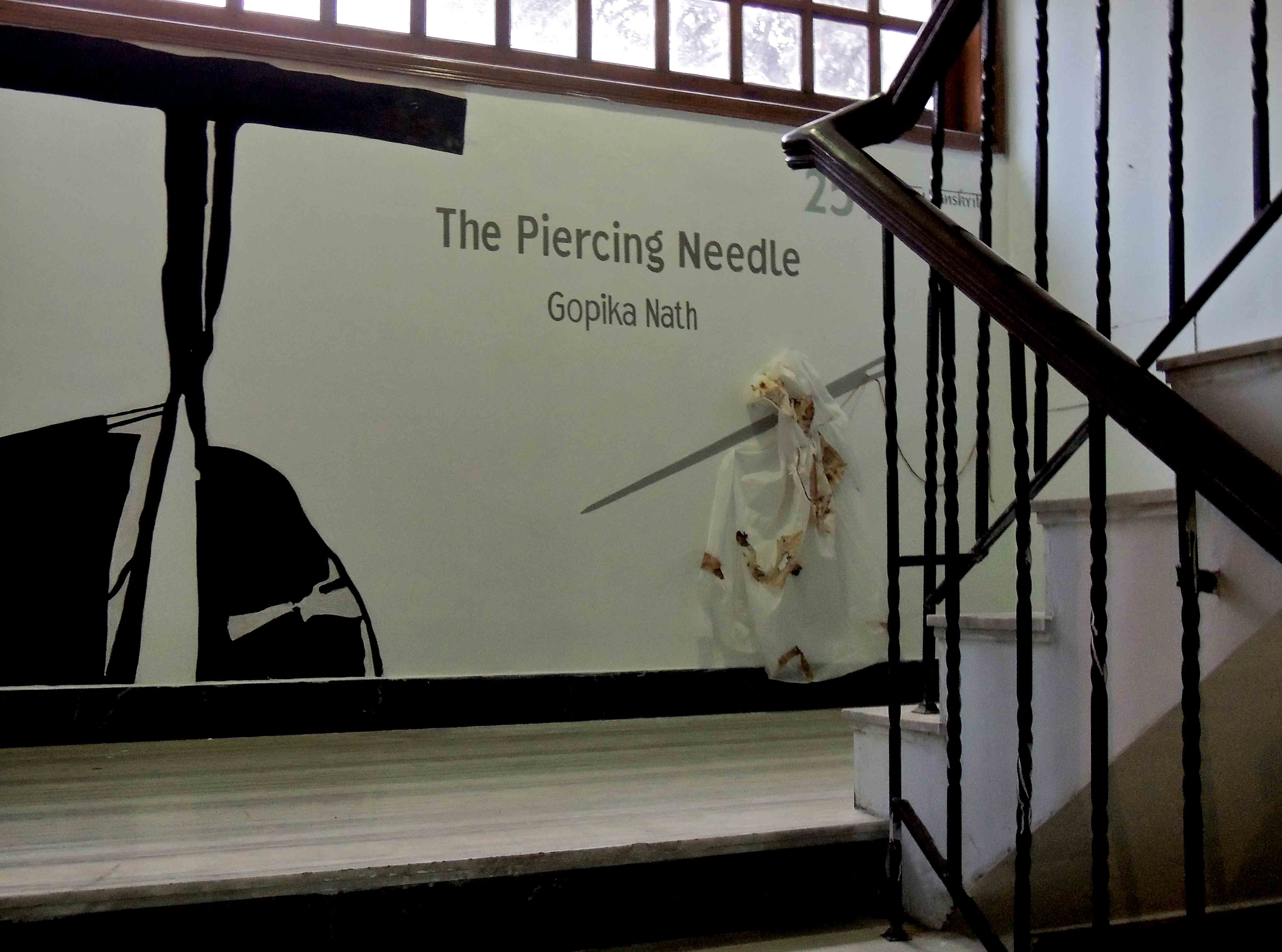 Image 3 : Display image of The Piercing Needle, In View: Display on staircase leading up to gallery, Photo credit: gopika nath