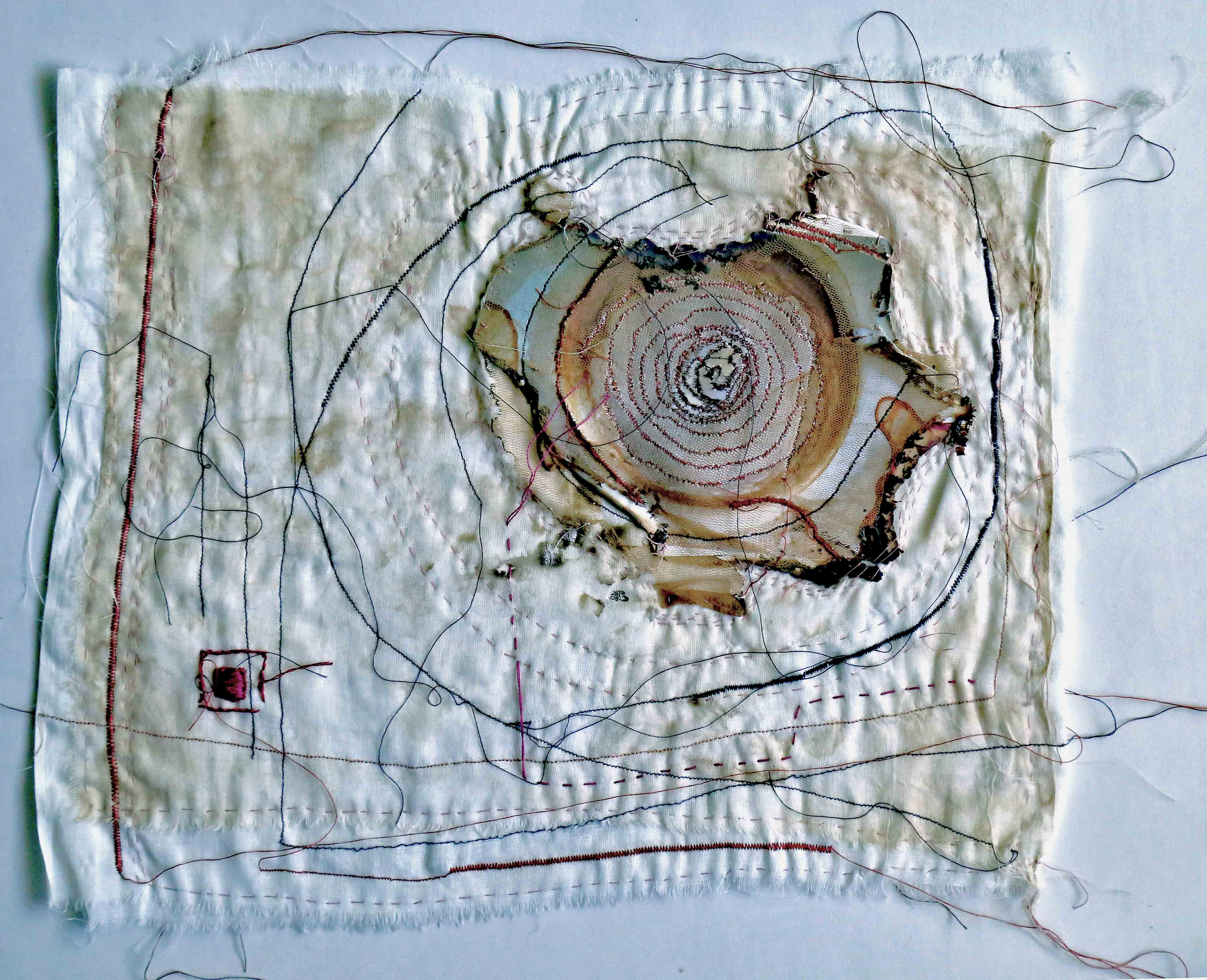 Memory Spiral, 2015, [10 x 12 inches – unframed, set of three], Materials: photographic paper, cotton fabrics, cotton floss cotton-polyester thread, Technique: burning, layering, hand-sewing, machine embroidery, staining with tea-leaves